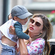 Miranda Kerr Picks Up Baby Flynn