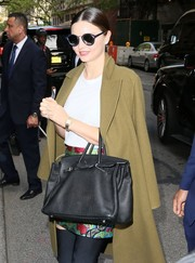 Miranda Kerr accessorized with a luxurious gold bracelet watch by Cartier while out in New York City.