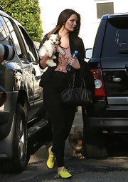 Just another day at the and Micha Barton shows off her little pup while toting around her Chanel chain strap purse.