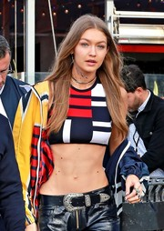 Gigi Hadid's leather belt added a Western touch to her look at the Tommy Hilfiger fashion show.