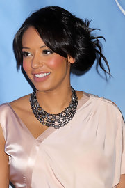 Spice girl Mel B, shows off a sparkling layered necklace that  appears to be one piece. Her silver necklace looks stunning against her champagne colored dress.