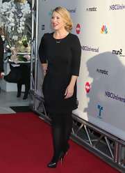 Christina Applegate opted for a monochromatic look at the 'NBC Universal' Press Tour, teaming her black dress with matching leather platform pumps and opaque tights.