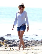 Naomi Watts chose a pair of denim shorts for her beachy look while out with her family.