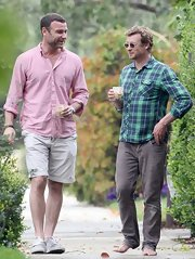 Liev Schrieber looked ready for spring when he sported a pastel pink button down and khaki shorts while visiting friend Simon Baker.
