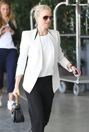 Naomi Watts sported a fitted white blazer with square shoulders while going out in Hollywood.
