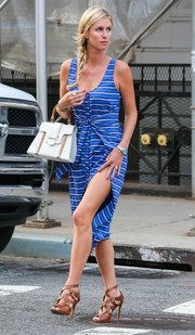 Nicky Hilton flaunted some leg in a striped tank dress with a thigh-high slit and a knotted waist while out and about in New York.