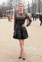 Nicky Hilton accessorized her feminine frock with black patent leather pumps.