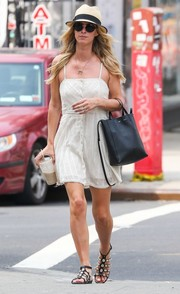 Nicky Hilton paired her mini dress with shell-embellished gladiator sandals by Azzedine Alaia.