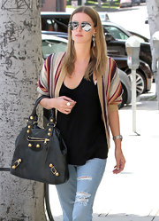 Nicky Hilton looked effortlessly stylish carrying a black leather tote with gold hardware.