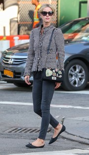 Nicky Hilton topped off her ensemble with a black Chanel Boy bag with crest embellishments.