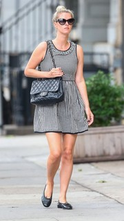Nicky Hilton added a luxurious touch with a quilted black Chanel bag.