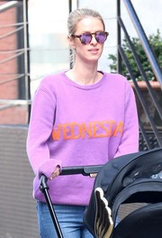 Nicky Hilton wore purple Illesteva shades to match her sweater while out on a stroll with her baby.