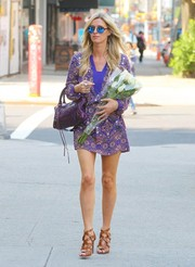 Nicky Hilton teamed her mini with stylish tan strappy sandals.