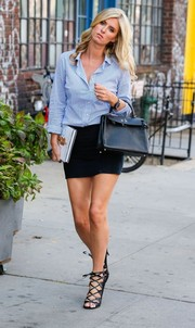 Nicky Hilton put a sexy spin on business wear by pairing a blue button-down with a black micro mini.