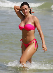 Nicole Bahls attracts attention in this bright pink bandeau bikini.