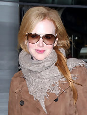 Nicole Kidman wore this textured ecru scarf for her trip to Paris.