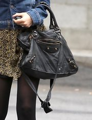 Nicole Richie paired her boho glam style with a coveted studded leather shoulder bag.