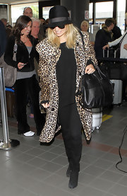 Nicole Richie carried a black leather tote bag through LAX airport.