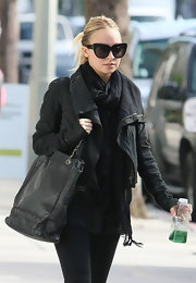 Nicole Richie donned dramatic cat eye shades while hitting the gym in LA.