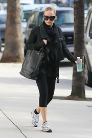 Nicole Richie switched up her Chanel gym bags with a larger, equally luxe black tote.