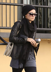 Nicole Richie left the gym in a black beanie and oversize square sunglasses.