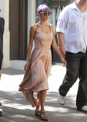 Nicole Richie exuded feminine appeal in a fluid pink silk dress white taking a coffee break.