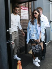 For her footwear, Nicole Scherzinger went sporty with a pair of white basketball sneakers.