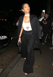 Nicole Scherzinger headed to Catch sporting a black wide-leg pantsuit and a white cutout top.
