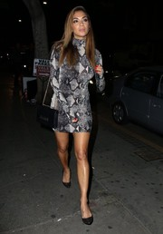 Nicole Scherzinger looked wildly sexy in a clingy, backless snakeskin-print mini by Michael Costello during the label's pre-Fall capsule collection party.