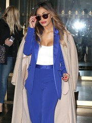 Nicole Scherzinger hid her eyes behind a pair of square shades as she stepped out of 'The Today Show' studio.