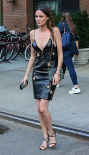 Nicole Trunfio turned heads in a black Bally leather dress, adorned with multiple grommeted cutouts, while exiting the Bowery Hotel.