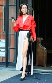 Nicole Trunfio headed out in New York City wearing a tricolor wrap dress with a dangerously high slit.