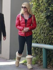 Nicollette Sheridan paired a puffy winter coat with black capri leggings.