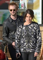 Nikki walked on the wild side in this animal print sweater and leather leggings while out with her fiance.