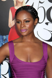 Tika Sumpter's style was a combination of sweet and sexy at the 'What's Your Number' premiere. To recreate her look, make a center part and collect hair into two sections, securing them behind the ears with hair elastics. Next, braid pigtails and pull them over the top of the head. Hide the ends under the braid and secure with bobby pins.