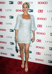 Sonja shimmered at the Ok Magazine party in a square-neck long-sleeved cocktail dress.