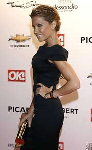 Sylvie Van Der Varrt showed off her pixie cut while attending the OK! Style Awards.