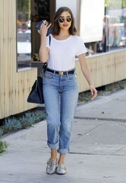 Olivia Culpo looked uncharacteristically low-key in a white T-shirt while shopping in West Hollywood.