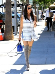 Olivia Munn punched up her casual look with gray suede thigh-high boots.