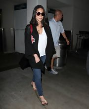 Olivia Munn rocked an oversize black cardigan with star-detailing on the breast.