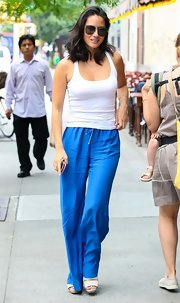 Olivia Munn showed off her fit figure with this classic white tank, which she paired with electric blue pants.
