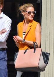 Olivia Palermo was spotted out in Soho looking retro-chic in her clear-rimmed Westward Leaning cateye sunnies.