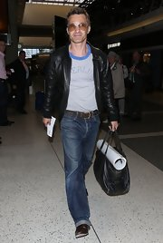Oliver Martinez chose this pair of classic straight-leg jeans for his relaxed travel look.