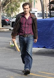 Olivier Martinez chose a dark chocolate brown leather bomber for his look while out grabbing groceries.