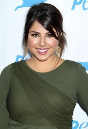 Daniella Monet wore a pair of gold leaf earrings at PETA's 30th Anniversary Gala.