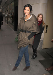 Padma Lakshmi looked casual chic in a pair of brown suede wedge boots, that paired perfectly with a belted olive jacket.