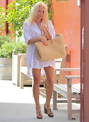 Pamela Anderson stepped out in Brentwood wearing a pair of strappy wedge sandals.