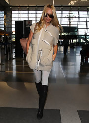 Pamela Anderson covered up at the airport in a buckled short-sleeved topper.