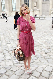 Nora Arnezeder went for a lovely retro look with this pin-dot dress during Paris Fashion Week.