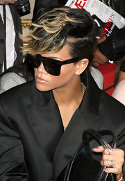 Rihanna loves her over-sized Wayfarer shades, as seen on every celeb these days.